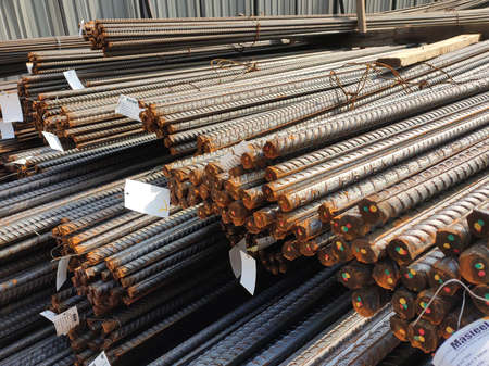 SHAH ALAM, MALAYSIA -OCTOBER 2, 2020: New supply of steel reinforcement bars at the construction site. Tagged according to factory order and material specifications.