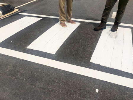 Zebra crossing for pedestrians on the road. Made of thermoplastic material and has light-reflective particles. Provides safety advantages to pedestrians.