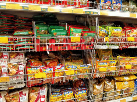 SEREMBAN, MALAYSIA -APRIL 2, 2020: The spices are sold in commercial packages and are displayed on shelves in the supermarket. Sort by brand and type to make it easier for customers to buy.