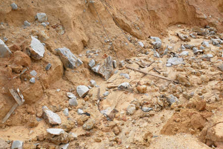 Erosion at ground and slopes is caused by rainfall. The soil structure is weak and there is a landslide. Safety measure has been taken in some area. Stock Photo