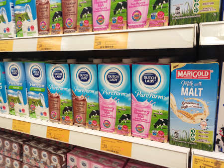 SEREMBAN, MALAYSIA -JULY 5, 2019: Processed and fresh milk packed in the paper box and displayed on the rack inside the supermarkets. Sorted by brand and type for easy for the customer to choose.