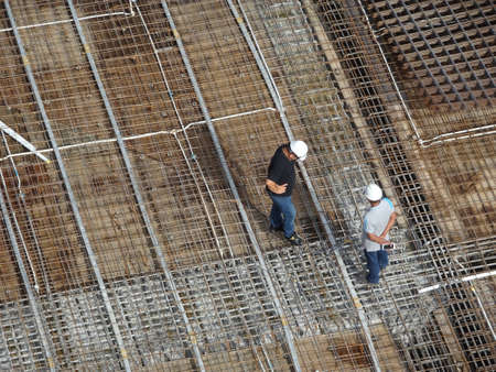 MALACCA, MALAYSIA -MAY 9, 2017: Construction workers having a discussion at the construction site. Important discussions to coordinate construction work.