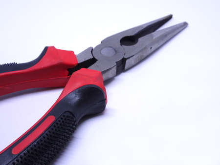 Needle Nose Pliers also known as pointy nose pliers or long nose pliers isolated on white background. Stock Photo