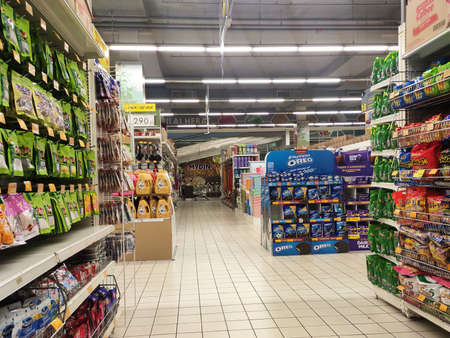 SEREMBAN, MALAYSIA -MARCH 2, 2021: Interior of a hypermarket. Daily necessities and groceries are displayed on sales shelves and price tagged. Sorted by type and brand. Editorial