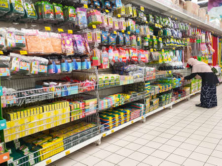 SEREMBAN, MALAYSIA -MARCH 2, 2021: Interior of a hypermarket. Daily necessities and groceries are displayed on sales shelves and price tagged. Sorted by type and brand.