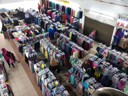 PENANG, MALAYSIA -MARCH 3, 2021: Selected focused on children's and adult clothing sold in supermarkets. Sorted by category and size. Placed a price tag for the convenience of customers.