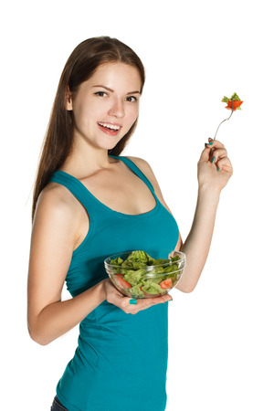 A young girl, a salad, healthy diet