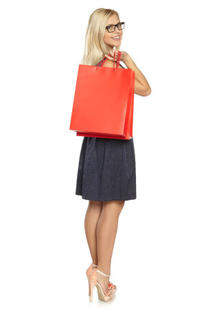 young girl in dress with packages photo