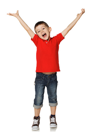 hand up: Little boy raised his hands and shouts