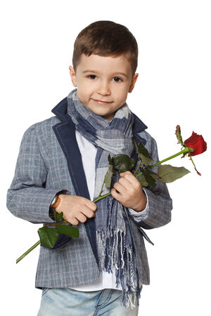 Little boy in a jacket with a rose in his hands. photo