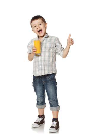 Little boy with a glass of juice lifts finger upwards  photo