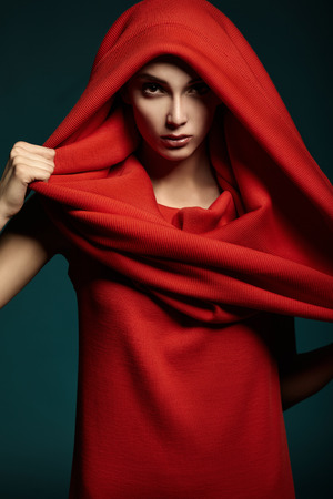 Beautiful woman with red hood  Fashion  Portrait  Close up