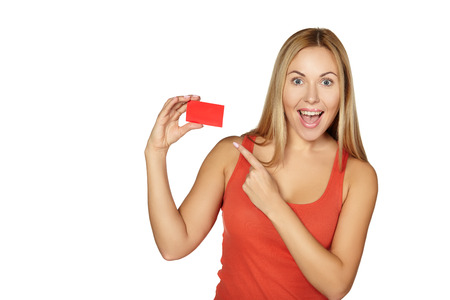 woman holding card: showing woman presenting blank gift card sign  Happy smiling  Stock Photo