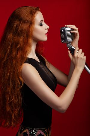heir: Portrait of singing woman, red heir, micprophone