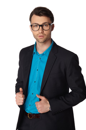 Young businessman black suit in glasses casual poses at studio Stock Photo