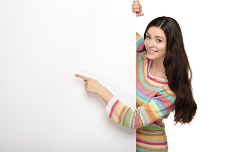 young smile woman standing pointing her finger at a blank board