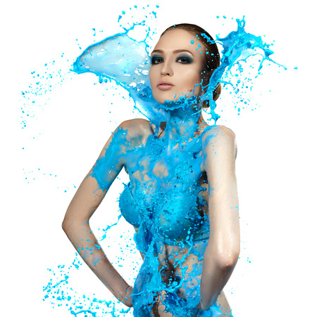 Sensual woman and big paint waves. Blue splash.