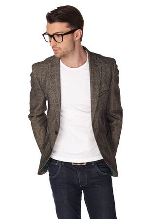 Young man with jacket over white background. Banco de Imagens