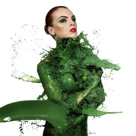 Beauty woman and big paint waves. Green splash.