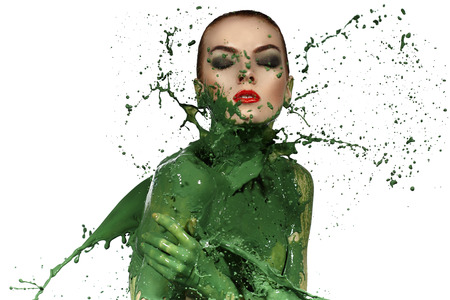 Beauty woman and big paint waves. Green splash.