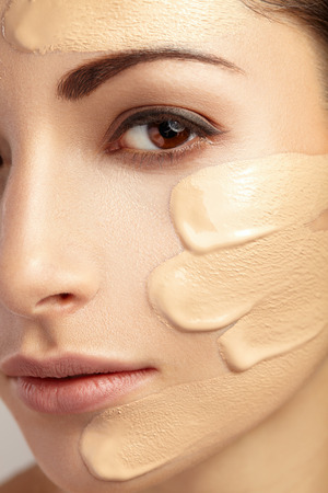 foundations: Young woman with cosmetic foundation on a skin. Stock Photo