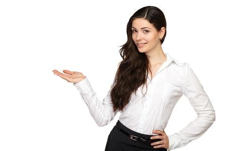 젊은 비즈니스 여자는 그의 손과 미소 가리키는. 흰색 배경입니다. 스톡 콘텐츠