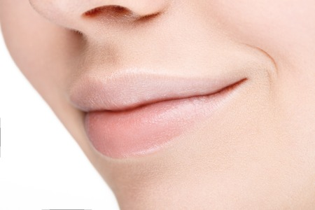 hot pink: Part of face with beautiful full lips without makeup. Close-up. Stock Photo