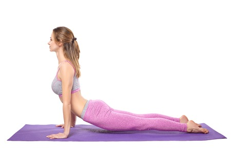 beginner: Attractive young sporty girl practicing yoga postures. White background.