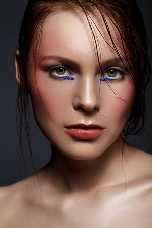 Art beauty studio photo of attractive womans face.