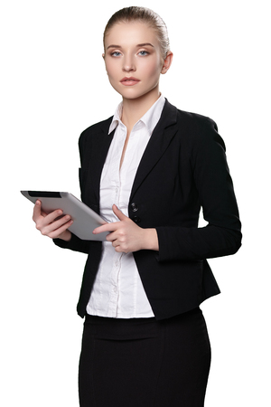 Portrait of a girl with a tablet in a suit on a white background
