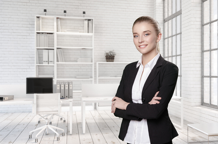 Portrait of a girl in a suit in a bright office.