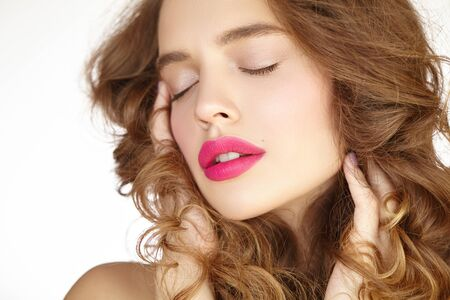 Close-up portrait of a beautiful girl with bright pink lips
