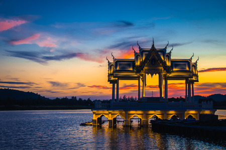 Abstract perspective Thai pavilion with twilight sky background at Khaotao beach, Hua-Hin, Thailand. This is tourist attraction.