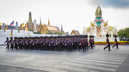 Soldiers march across the Grand Palace in Bangkok, Thailand to celebate the King rama9 birth anniversary on 3 Decemer 2015, Bangkok, Thailand. Editorial