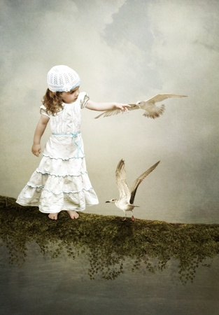 The girl and the seagulls,girl gets acquainted with the birds Stock Photo - 17851245