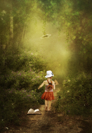 A little girl goes to the magical land of fairy tales Stock Photo