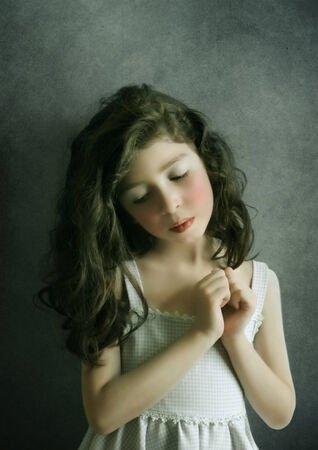 art processing:  Portrait of the little girl on a vintage background