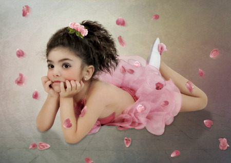 reverie: The little ballerina  in pink dress in rose petals