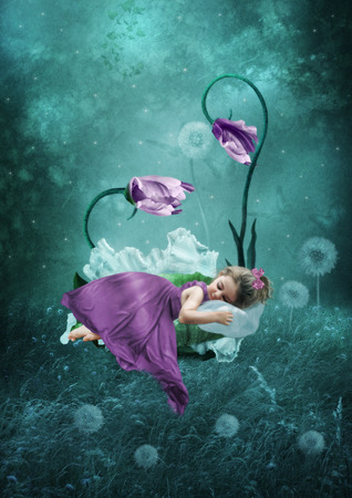 Sleeping little girl in magical forest