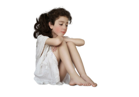 nightgown: Little girl with sad eyes on white background
