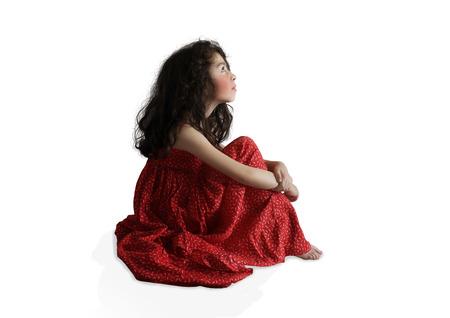 sundress: Little girl in red sundress with long hair Stock Photo