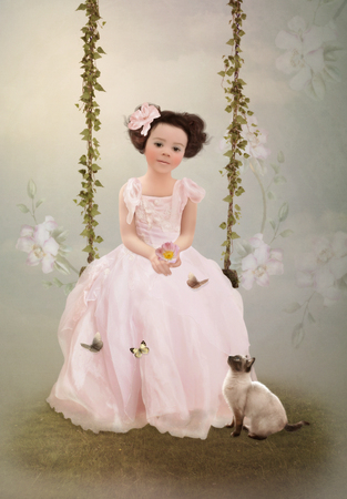 Girl in pink dress and kitten photo