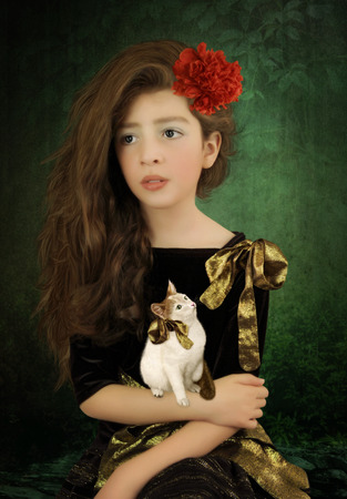 eyeing: Portrait of a little girl with long hair and kitten