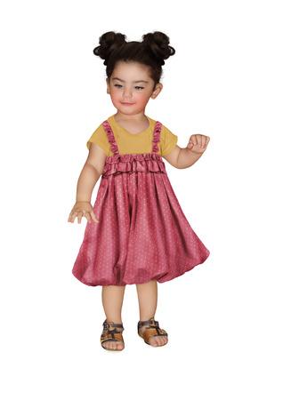 sundress: Baby girl in polka-dot sundress looks down Stock Photo