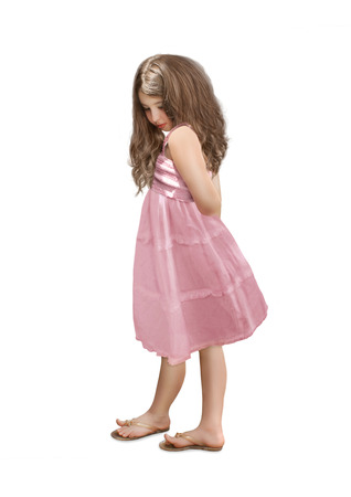 children clothing: Little girl with long hair in pink dress looking down