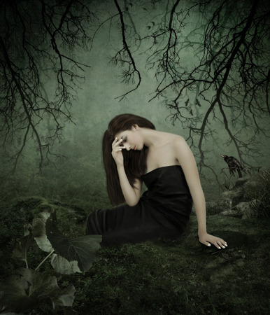 jungle girl: Young sad girl with long hair, his head bowed, in forest