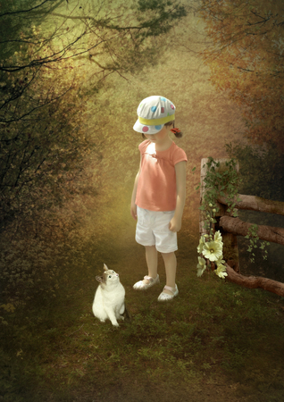 acquaintance: Little girl and kitten at the forest edge Stock Photo