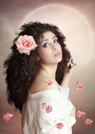 eyeing: Young girl with long, curly hair with Rose Stock Photo