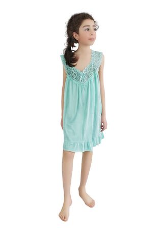 The smiling small girl in a blue nightie barefoot