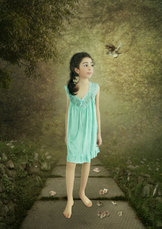 nightgown: Little girl smiling in a blue nightgown is walking Stock Photo